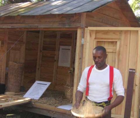 De Gullah Singers demonstrate rice winnowing