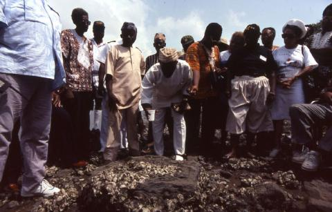Gullah Homecoming party participating in a libation ceremony at Bunce Island, Sierra Leone (1989)  Photo by Maggie Steber