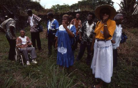 Gullah Homecoming group examining the ruins of the slave prison at Bunce Island (1989)  Photo by Maggie Steber